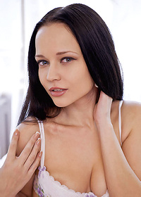 Black haired beauty girl spreading her pussy