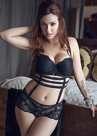Glamorous babe in black lingerie