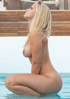 Naked busty Miela playing by the pool