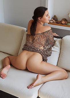 Jasmine Jazz Is Posing On Couch